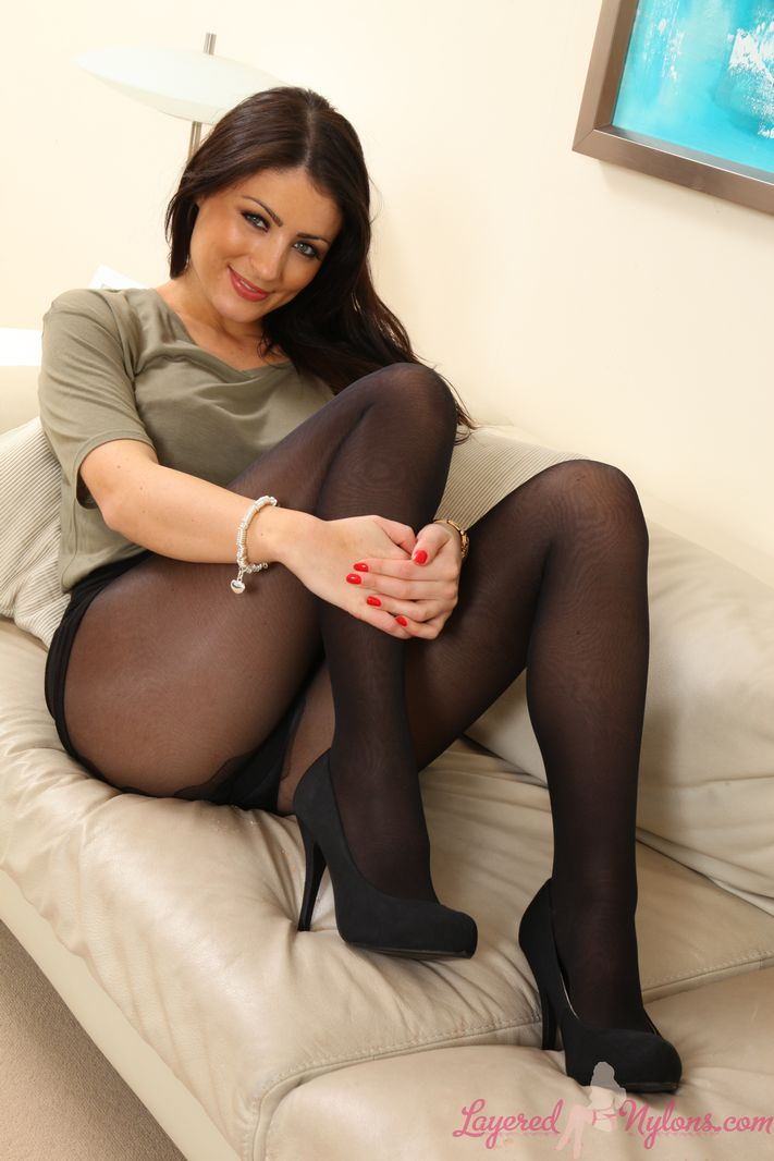 Stunning secretary in mini skirt and sexy layered legwear